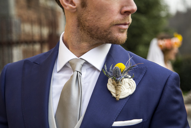 Custom-made blue dresses with contrasting gray waistcoats, white shirt, gray tie, white pochette and boutonnière
