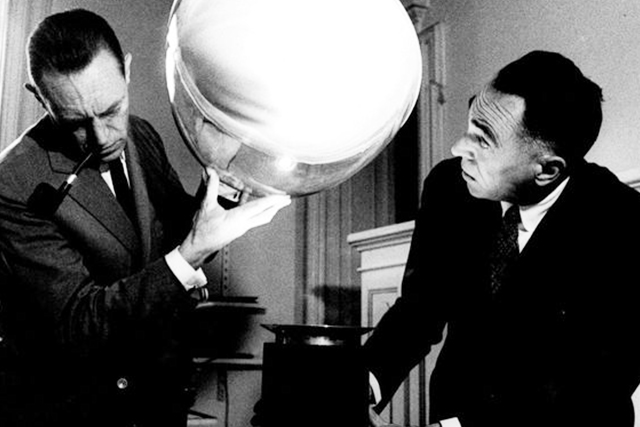 The brothers, Pier Giacomo and Achille Castiglioni with their lamp