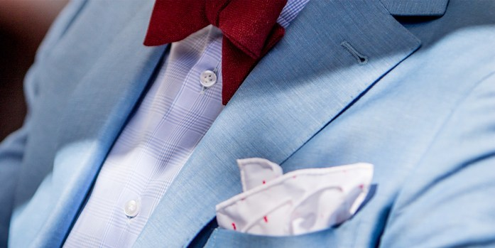 light-blue linen suit, combined with pocket square and customised bow tie