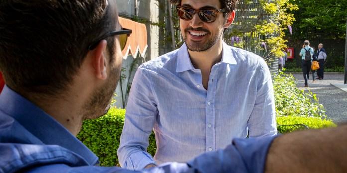 A man wearing a custom light blue shirt with standard placket