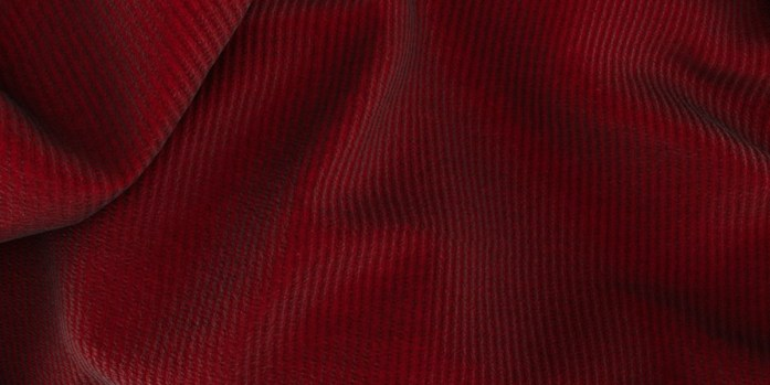 Detail of 100% cotton red fabric in corduroy