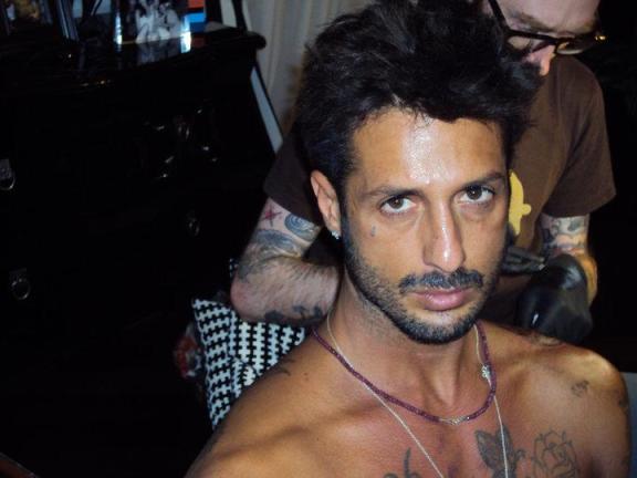 Foto Fabrizio Corona che attacca Belen Rodriguez