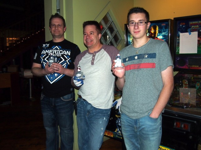 Aaron #2, Andy #1, Andrew #3, in the side tournament, with their tiny snowman trophies.
