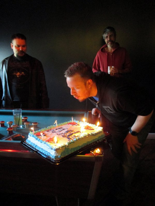 Mike blows out the candles