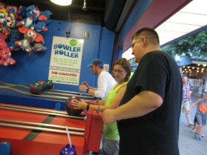 Mike, Christine, and Jake playing the Bowler Roller game.