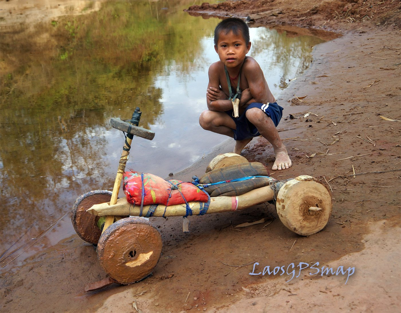 Kids having fun with a home made cart on the Ho Chi Minh Trail