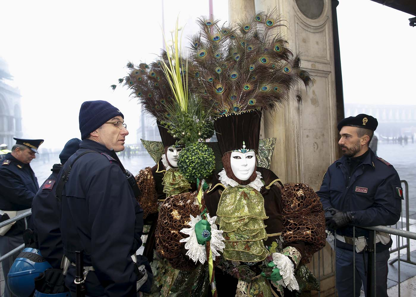 Italian policemen check masked revellers as they arrive at San Marco Piazza during the Venice Carnival, January 31, 2016. REUTERS/Alessandro Bianchi