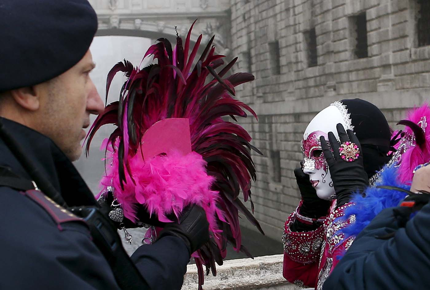 Italian policemen check masked revellers as they arrive at San Marco Piazza during the Venice Carnival, January 31, 2016. REUTERS/Alessandro Bianchi TPX IMAGES OF THE DAY