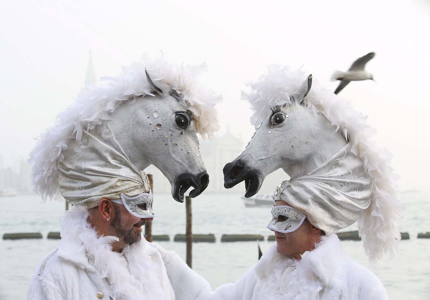 Masked revellers pose at San Marco Piazza during the Venice Carnival, January 31, 2016. REUTERS/Alessandro Bianchi