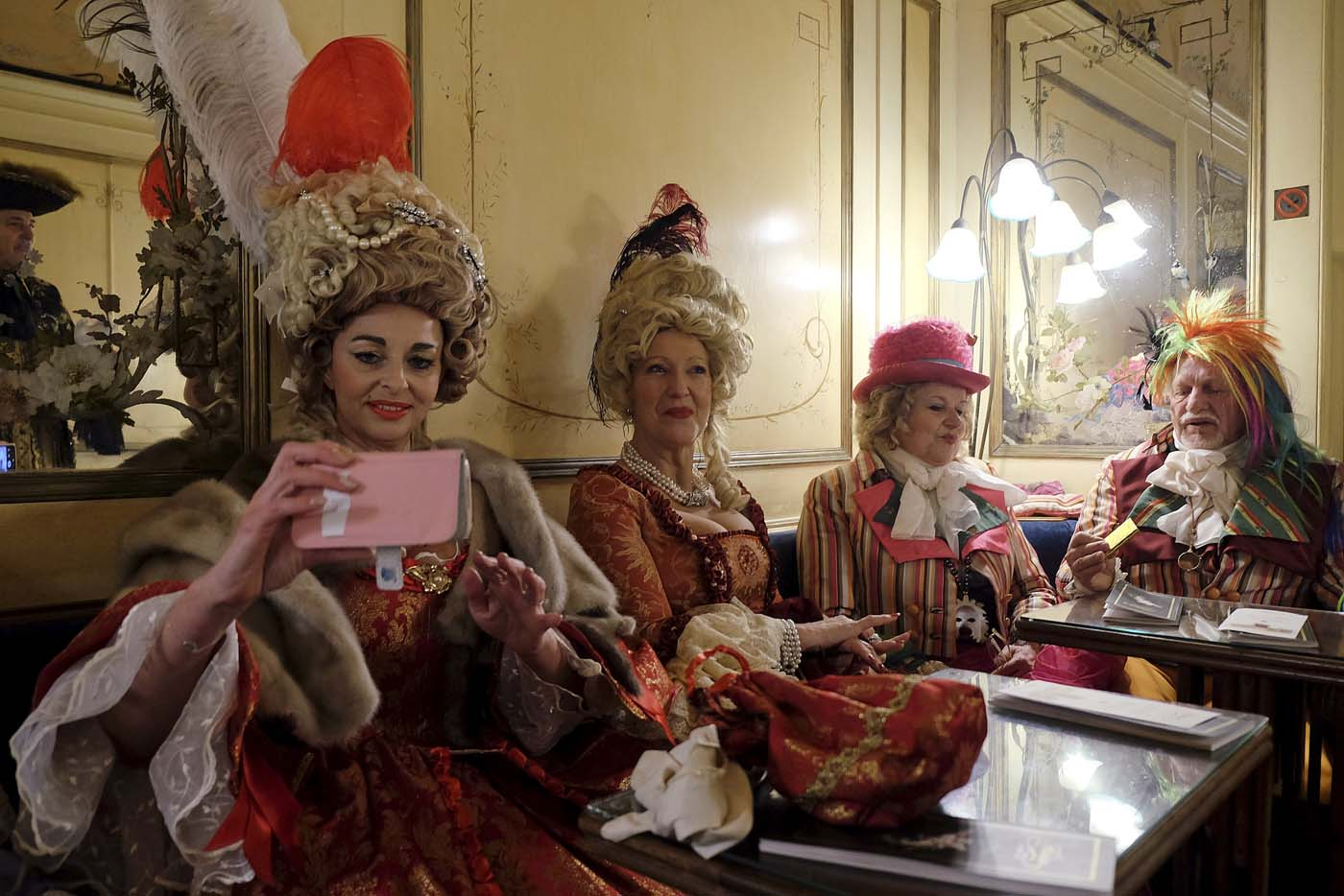 Revellers are seen in the Caffe Florian coffee shop in Saint Mark's Square during the Venice Carnival, Italy January 31, 2016. REUTERS/Manuel Silvestri