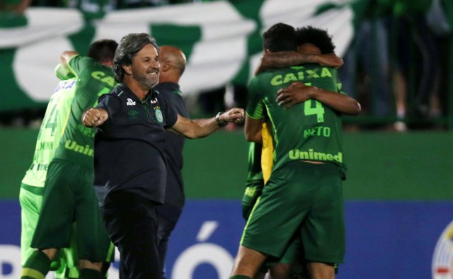 FILE PHOTO - Head coach Caio Junior of Chapecoense celebrates with his players after their match against San Lorenzo in the Copa Sudamericana at the Arena Conda stadium in Chapeco, Brazil, November 23, 2016. An aircraft with 81 people aboard, including Brazilian football team Chapecoense, crashed in central Colombia, the country's civil aviation association said on its website on November 29, 2016. REUTERS/Paulo Whitaker/File photo