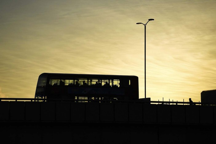 A double decker bus carries commuters as they make their way across London Bridge as the sun rises over London, Britain November 30, 2016. REUTERS/Dylan Martinez