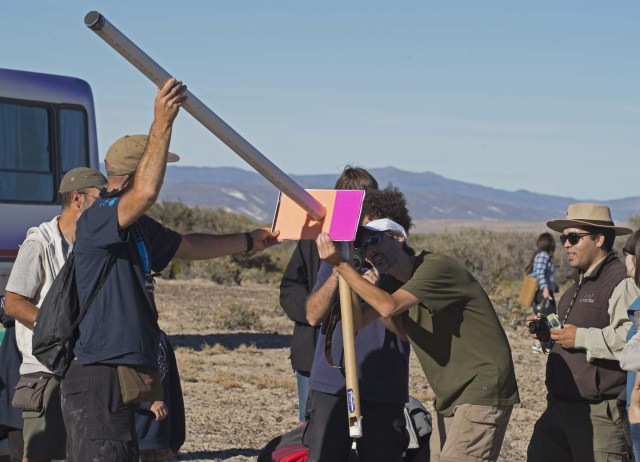 "Picture taken on February 26, 2017 showing people preparing to see an annular solar eclipse, at the Estancia El Muster, near Sarmiento, Chubut province, 1600 km south of Buenos Aires, Argentina, on February 26, 2017. Stargazers applauded as they were plunged into darkness Sunday when the moon passed in front of the sun in a spectacular ""ring of fire"" eclipse. / AFP PHOTO / ALEJANDRO PAGNI"