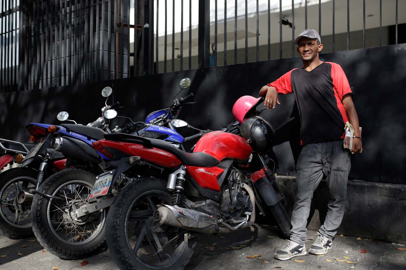 Denny Benitez looks after motorbikes at Plaza Brion square, in Caracas, Venezuela February 23, 2017. Picture taken February 23, 2017. REUTERS/Marco Bello