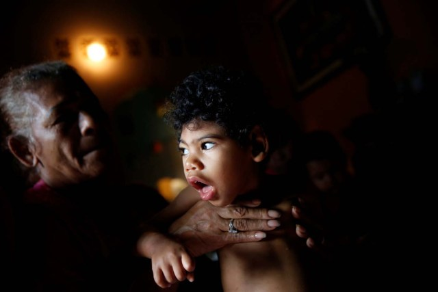 """Kaleth Heredia, 2, neurological patient being treated with anticonvulsants, is carried by his grandmother Isabel Buelvas at their house in Caracas, Venezuela January 30, 2017. REUTERS/Carlos Garcia Rawlins SEARCH """"EPILEPSY CARACAS"""" FOR THIS STORY. SEARCH """"WIDER IMAGE"""" FOR ALL STORIES."""
