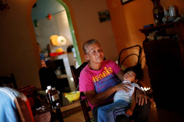 """Isabel Buelvas takes a break while she gives a meal to her grandson Kaleth Heredia, 2, a neurological patient being treated with anticonvulsants, at their house in Caracas, Venezuela January 30, 2017. REUTERS/Carlos Garcia Rawlins SEARCH """"EPILEPSY CARACAS"""" FOR THIS STORY. SEARCH """"WIDER IMAGE"""" FOR ALL STORIES."""