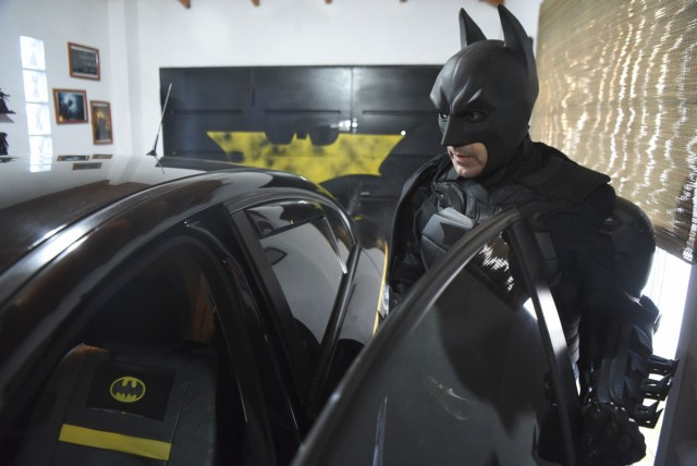 Argentine Batman, gets into his 'Batmobile' at his house's garage in La Plata, 60 kilometres south of Buenos Aires, on June 2, 2017.  The Argentine Batman has made La Plata children's hospital a target of laughter and treats against pain. / AFP PHOTO / Eitan ABRAMOVICH