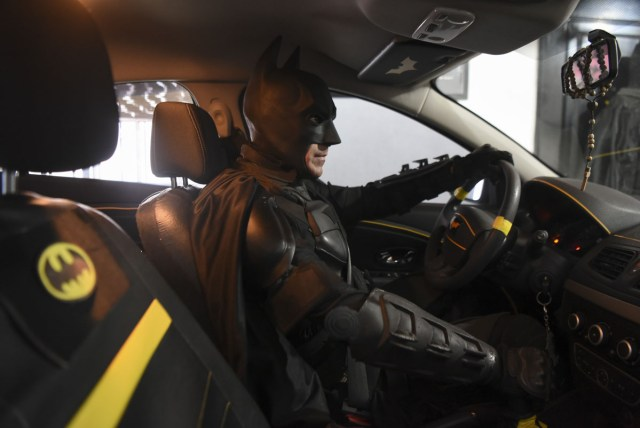 Argentine Batman, powers his 'Batmobile' and heads to the 'Sor Maria Ludovica' children's Hospital in La Plata, 60 kilometres south of Buenos Aires, on June 2, 2017.  The Argentine Batman has made La Plata children's hospital a target of laughter and treats against pain. / AFP PHOTO / Eitan ABRAMOVICH / TO GO WITH AFP STORY BY PAULA BUSTAMANTE MORE PICTURES IN AFPFORUM