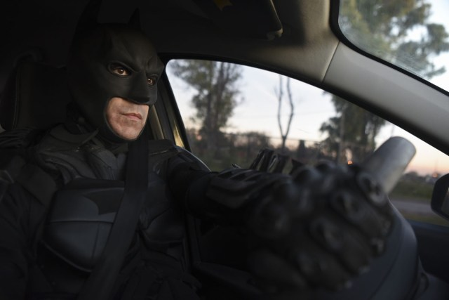 Argentine Batman, powers his 'Batmobile' and heads to the 'Sor Maria Ludovica' children's Hospital in La Plata, 60 kilometres south of Buenos Aires, on June 2, 2017.  The Argentine Batman has made La Plata children's hospital a target of laughter and treats against pain. / AFP PHOTO / Eitan ABRAMOVICH