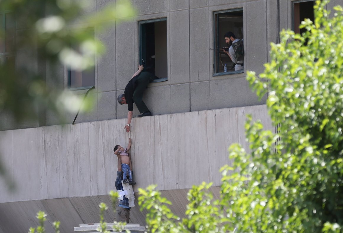 A boy is evacuated during an attack on the Iranian parliament in central Tehran, Iran, June 7, 2017. Omid Vahabzadeh/TIMA via REUTERS ATTENTION EDITORS - THIS IMAGE WAS PROVIDED BY A THIRD PARTY. FOR EDITORIAL USE ONLY.