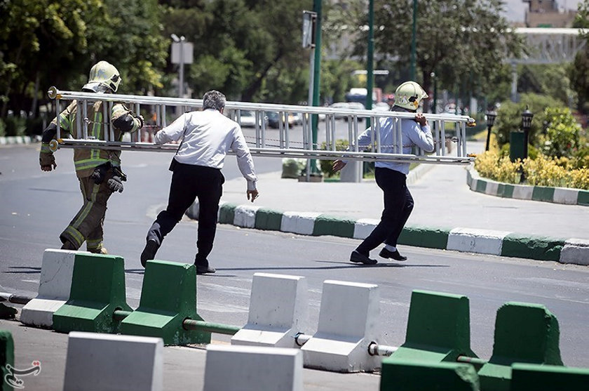 Members of Iranian civil defence run during an attack on the Iranian parliament in central Tehran, Iran, June 7, 2017. Tasnim News Agency/Handout via REUTERS ATTENTION EDITORS - THIS PICTURE WAS PROVIDED BY A THIRD PARTY. FOR EDITORIAL USE ONLY. NO RESALES. NO ARCHIVE.