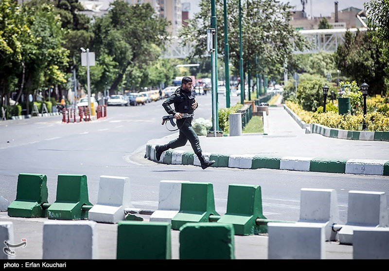 A member of Iranian forces runs during an attack on the Iranian parliament in central Tehran, Iran, June 7, 2017. Tasnim News Agency/Handout via REUTERS ATTENTION EDITORS - THIS PICTURE WAS PROVIDED BY A THIRD PARTY. FOR EDITORIAL USE ONLY. NO RESALES. NO ARCHIVE.
