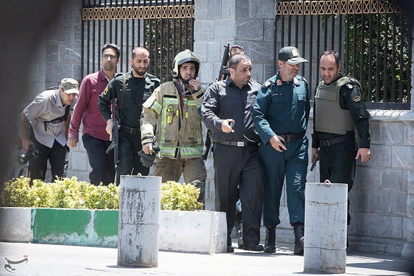 Members of Iranian forces are seen during an attack on the Iranian parliament in central Tehran, Iran, June 7, 2017. Tasnim News Agency/Handout via REUTERS ATTENTION EDITORS - THIS PICTURE WAS PROVIDED BY A THIRD PARTY. FOR EDITORIAL USE ONLY. NO RESALES. NO ARCHIVE.