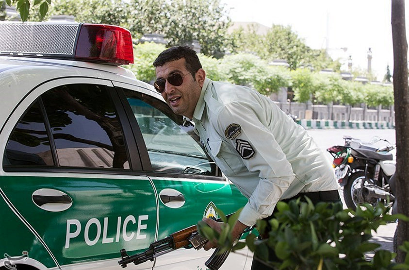 An Iranian policeman takes cover during an attack on the Iranian parliament in central Tehran, Iran, June 7, 2017. Tasnim News Agency/Handout via REUTERS ATTENTION EDITORS - THIS PICTURE WAS PROVIDED BY A THIRD PARTY. FOR EDITORIAL USE ONLY. NO RESALES. NO ARCHIVE.