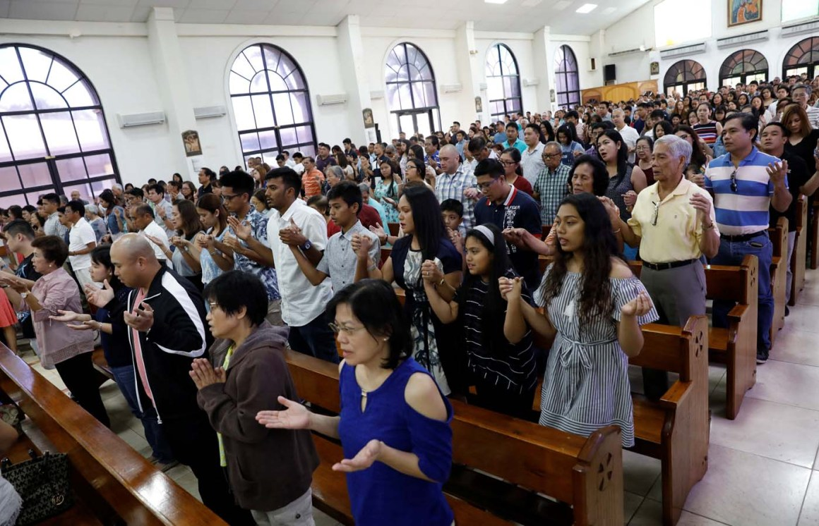 Residents pray during a Sunday mass at Sta Barbara Church on the island of Guam, a U.S. Pacific Territory, August 13, 2017.  REUTERS/Erik De Castro