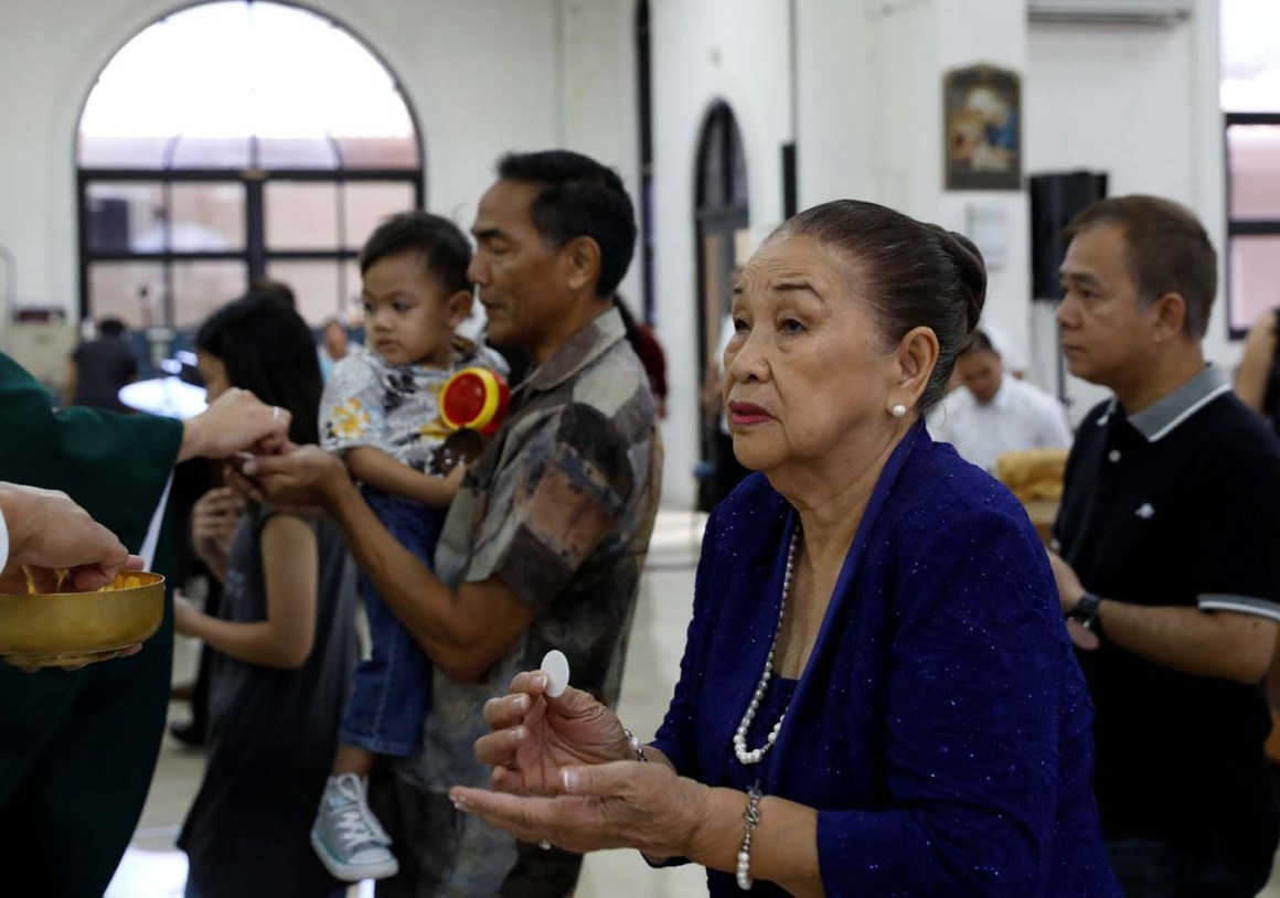 Local residents receive Holy Communion during a Sunday mass at Sta Barbara Church on the island of Guam, a U.S. Pacific Territory, August 13, 2017.  REUTERS/Erik De Castro