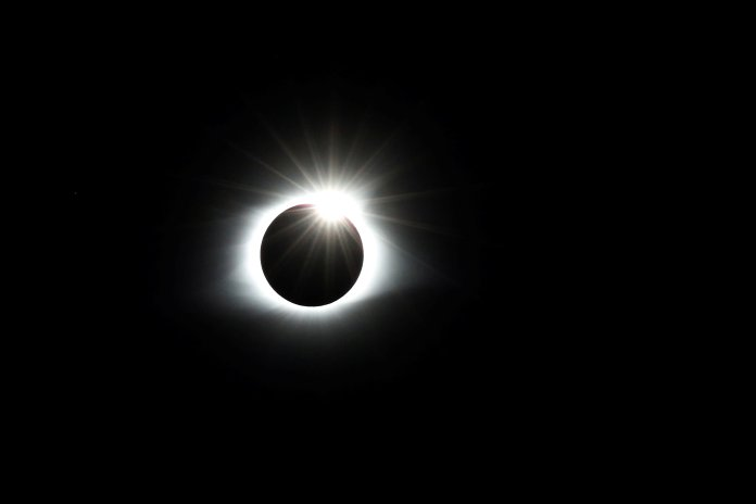 "The solar eclipse creates the effect of a diamond ring at totality as seen from Clingmans Dome, which at 6,643 feet (2,025m) is the highest point in the Great Smoky Mountains National Park, Tennessee, U.S. August 21, 2017. Location coordinates for this image are 35º33'24"" N, 83º29'46"" W. REUTERS/Jonathan Ernst"