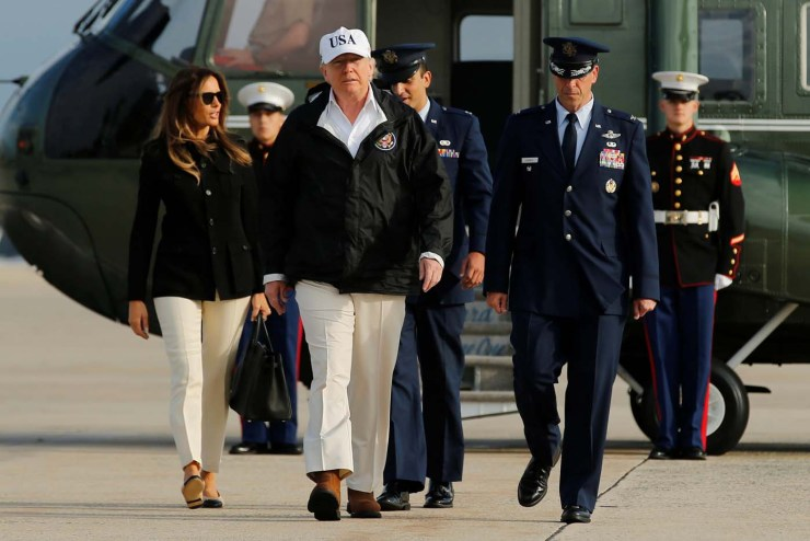 U.S. President Donald Trump and First Lady Melania Trump (L) board Air Force One for travel to view Hurricane Irma response efforts in Florida, from Joint Base Andrews, Maryland, U.S. September 14, 2017. REUTERS/Jonathan Ernst