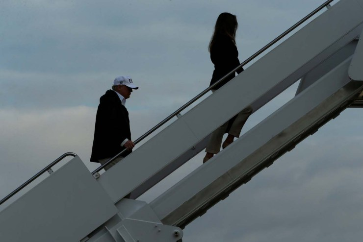U.S. President Donald Trump and First Lady Melania Trump (R) board Air Force One for travel to view Hurricane Irma response efforts in Florida, from Joint Base Andrews, Maryland, U.S. September 14, 2017. REUTERS/Jonathan Ernst