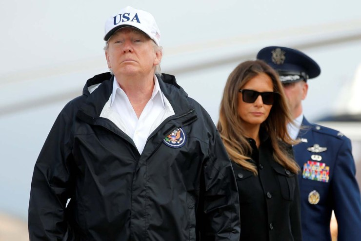U.S. President Donald Trump and First Lady Melania Trump board Air Force One for travel to view Hurricane Irma response efforts in Florida, from Joint Base Andrews, Maryland, U.S. September 14, 2017. REUTERS/Jonathan Ernst