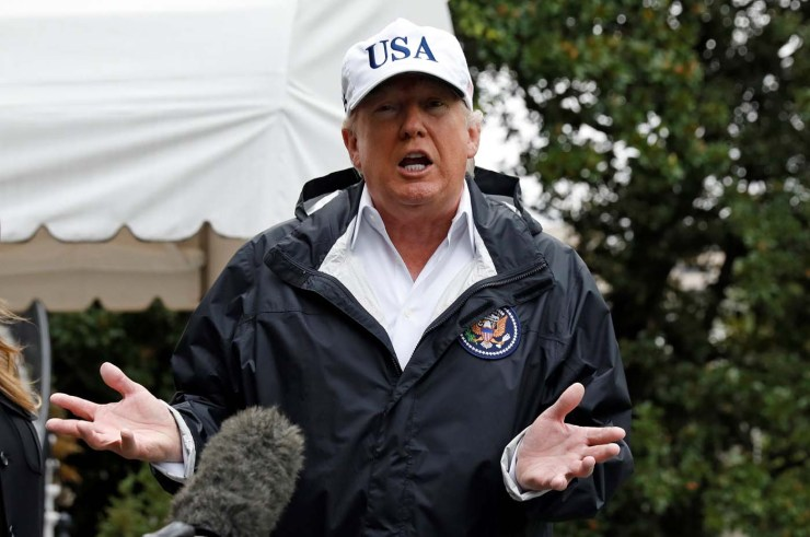 U.S. President Donald Trump speaks to reporters as he departs the White House in Washington on his way to view storm damage in Florida, U.S., September 14, 2017. REUTERS/Kevin Lamarque
