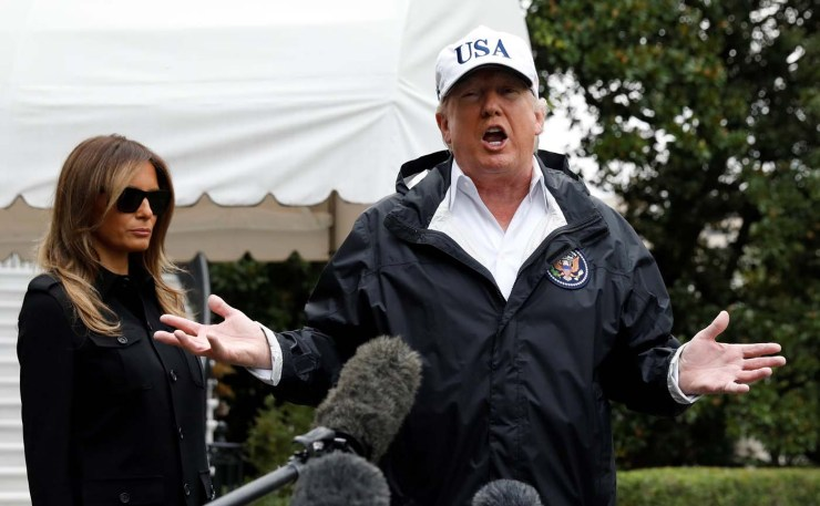 U.S. President Donald Trump speaks to reporters as he and First Lady Melania Trump depart the White House in Washington on their way to view storm damage in Florida, U.S., September 14, 2017. REUTERS/Kevin Lamarque