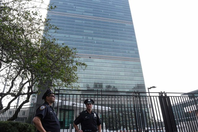 Members of the New York City police department stand guard in front of the United Nations building in New York City, U.S. September 17, 2017. REUTERS/Stephanie Keith