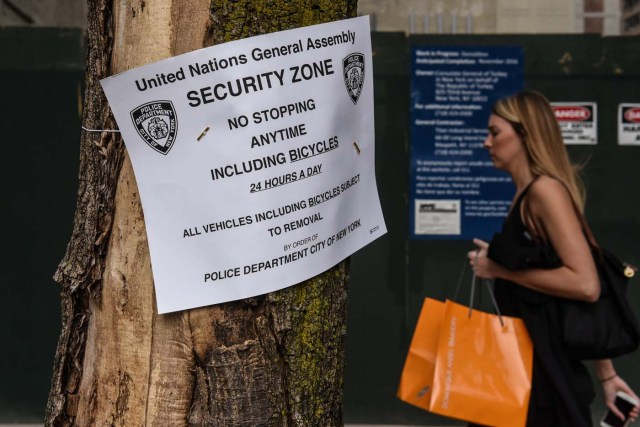A pedestrian passes a sign announcing a security zone as the New York City police department heightens security before the start of the United Nations General Assembly in New York City, U.S. September 17, 2017. REUTERS/Stephanie Keith