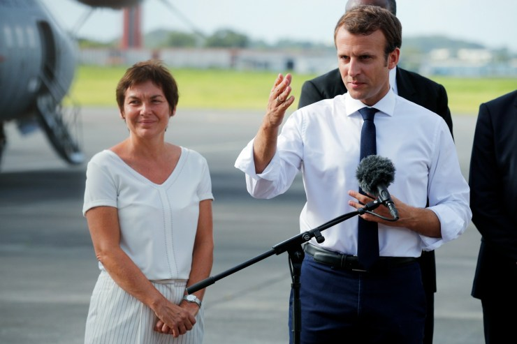 France's President Emmanuel Macron (R), next to French Overseas Minister Annick Girardin (L), addresses the media upon his arrival in Pointe-a-Pitre, Guadeloupe island, the first step of his visit to French Caribbean islands on September 12, 2017.  Christophe Ena / AFP