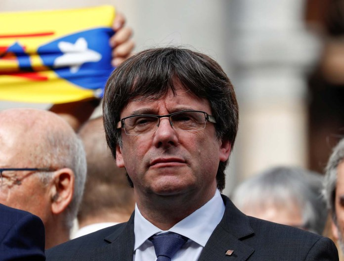 Catalan President Carles Puigdemont stands and other regional government members in Plaza Sant Jaume as they join a protest called by pro-independence groups for citizens to gather at noon in front of city halls throughout Catalonia, in Barcelona, Spain October 2, 2017. REUTERS/Juan Medina