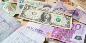 World currencies - including US Dollars, Euros, Chinese Yuan, British Pounds