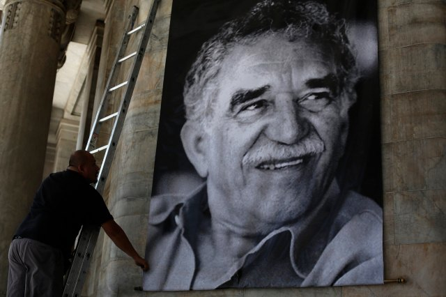 Worker arranges a banner with the picture of late Colombian Nobel Prize laureate Garcia Marquez at the Bellas Artes palace in Mexico City