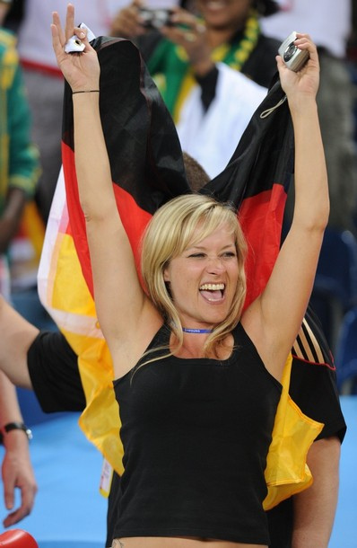 A supporter of Germany celebrates after