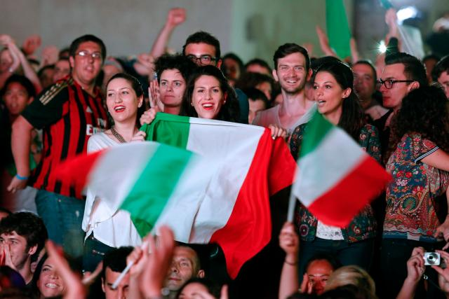 People cheer as they watch the 2014 World Cup soccer match between Italy and England during a public viewing event in downtown Rome
