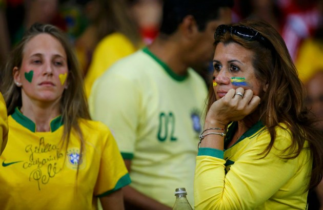 Brazil fans react at half-time during the team's  2014 World Cup semi-finals against Germany at the Mineirao stadium in Belo Horizonte