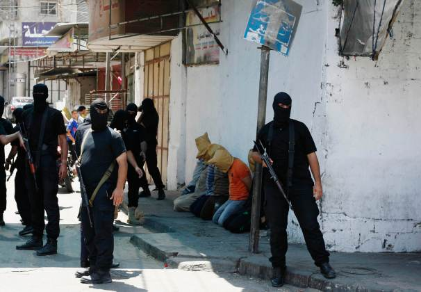 Hamas militants surround Palestinians suspected of collaborating with Israel in Gaza City