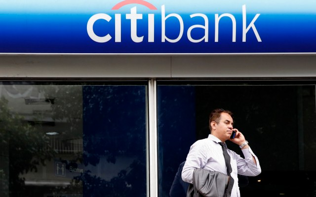 A man speaks on the phone outside a Citibank branch in Caracas
