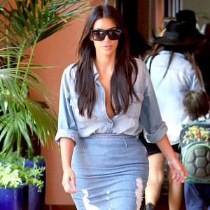rs_300x300-140822135621-600.Kim-Kardashian-Distressed-Denim.jl.082214