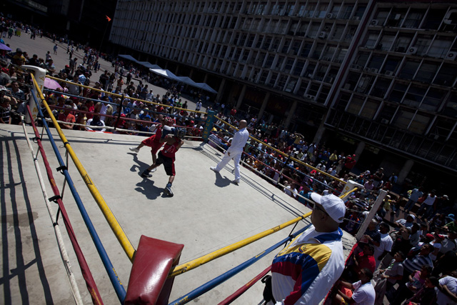 Children exchange punches during their fight in a Olympics-style street boxing championships in Caracas