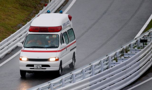 An ambulance is dispatched after the race was stopped following a crash by Marussia Formula One driver Jules Bianchi of France at the Japanese F1 Grand Prix at the Suzuka Circuit